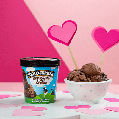 A pint of Chocolate Fudge Brownie and a bowl of it with heart around it